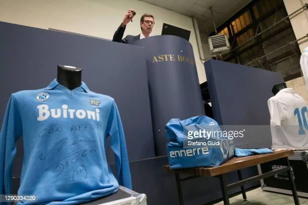 "Auctioneer sells a Diego Armando Maradona shirt during of the ""Sport Memorabilia"" auction on December 09, 2020 in Turin, Italy. ""Sport Memorabilia""..."