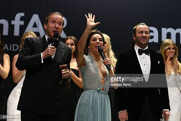 Auctioneer Simon De Pury, actress Eva Longoria and designer Tom Ford onstage during amfAR's 22nd Cinema Against AIDS Gala, Presented By Bold Films...