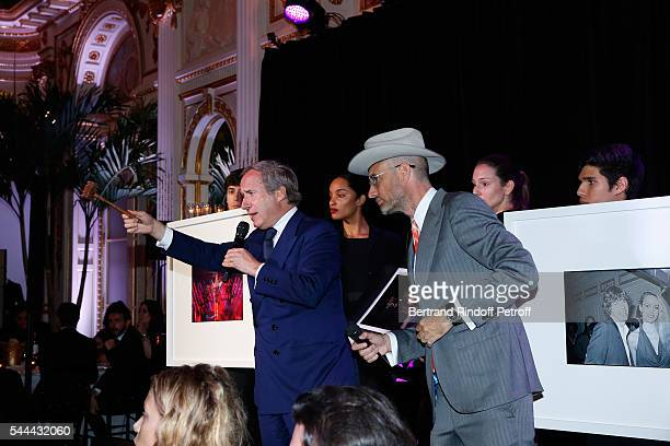 Auctioneer Simon de Pury and Andrew Boose host the Auction sale during the Amfar Paris Dinner Stars gather for Amfar during the Haute Couture Week...