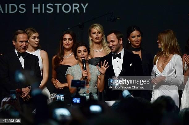 Auctioneer Simon de Pury model Gigi Hadid model Irina Shayk actress Eva Longoria model Karolina Kurkova designer Tom Ford and model Adriana Lima and...