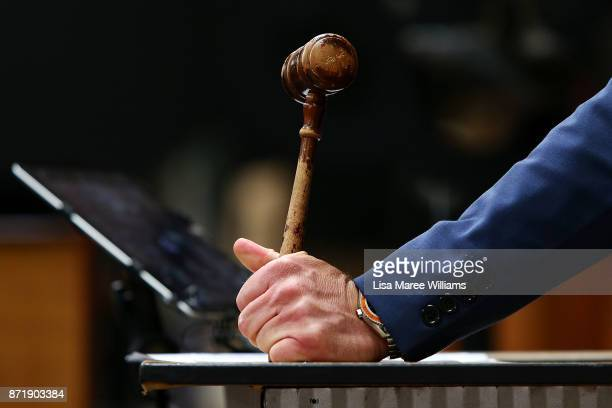 Auctioneer Simon Hill takes bids during the sale of the 2000 Olympic Gold Medal won by Michael Diamond on November 9 2017 in Sydney Australia Michael...