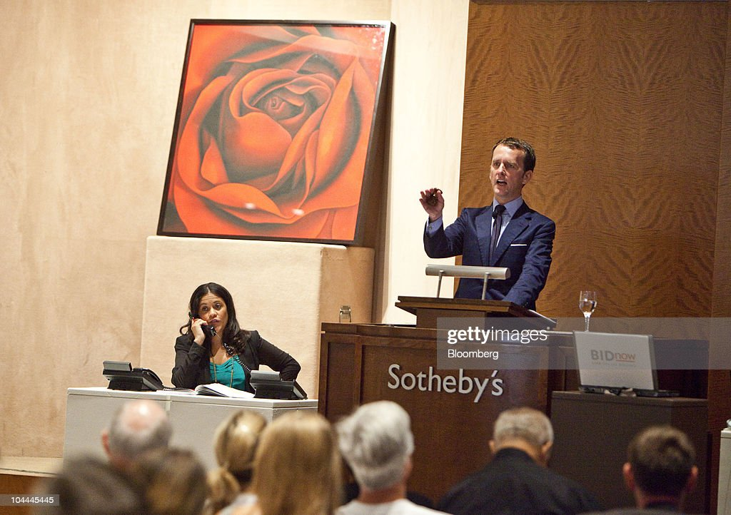 Auctioneer, Tobias Meyer, right, auctions an untitled painting by Robert Longo as part of Lehman Brother's artwork collection at Sotheby's in New York, U.S., on Saturday, Sept. 25, 2010. Artworks being auctioned from the collection of Lehman Brothers Holdings Inc. may raise another $16 million for its creditors as collectors and souvenir hunters snap up remains of the collapsed bank. Photographer: Ramin Talaie/Bloomberg via Getty Images