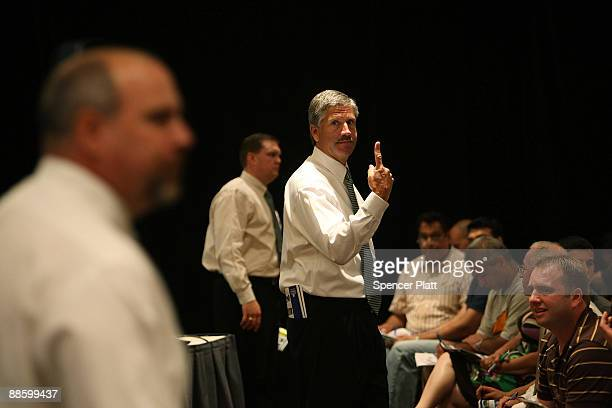 Auctioneers from Hudson Marshall takes bids during a auction for more than 25 forclosed homes at the Renaissance Newark Airport Hotel on June 20 2009...