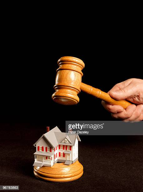 Auctioneer's gavel on house