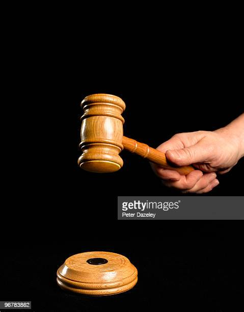 auctioneer's hammer on black background - auction stock pictures, royalty-free photos & images