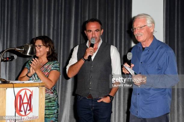 Auctioner Lucie Donikian Nikos Aliagas and Yann ArthusBertrand attend 'Les Amis de Yann ArthusBertrand se Vendent aux Encheres' Auction in Domaine de...