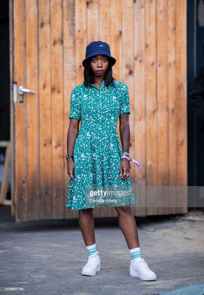 b9b100a4c Aude-Julie Alingue wearing bucket hat, green dress seen during the ...