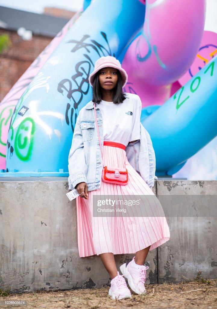 c5a48ec50 Aude-Julie Alingue wearing pink bucket hat, denim jacket, pink midi ...