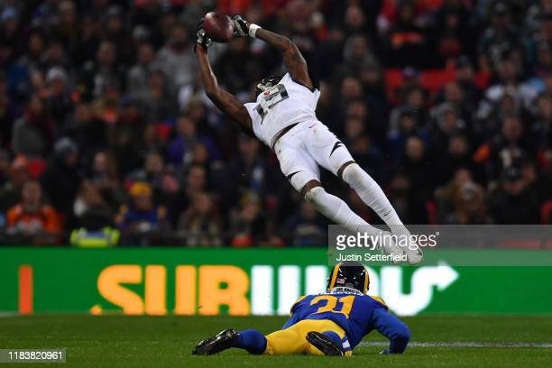 Auden Tate of the Cincinnati Bengals takes a catch under pressure from Darious Williams of the Los Angeles Rams during the NFL London Games series...
