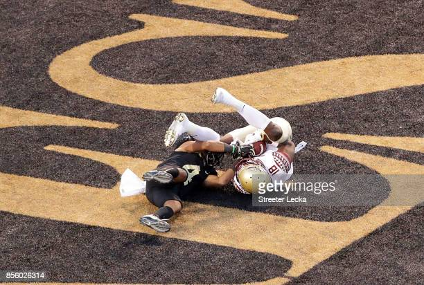 Auden Tate of the Florida State Seminoles catches a touchdown against Amari Henderson of the Wake Forest Demon Deacons during their game at BBT Field...