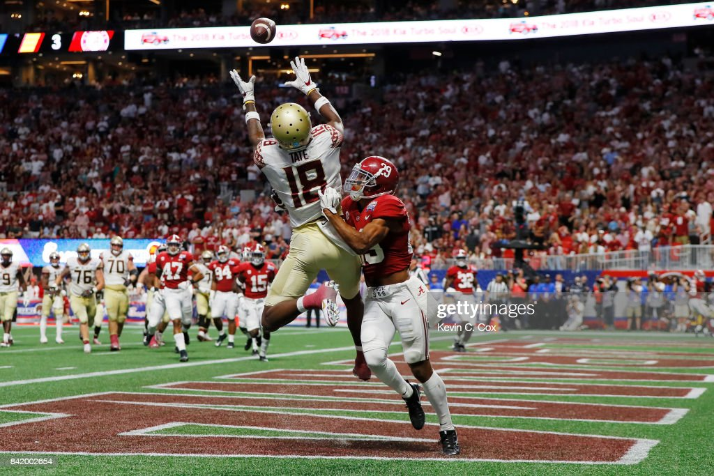 Auden Tate #18 of the Florida State Seminoles makes a catch for a touchdown as Minkah Fitzpatrick #29 of the Alabama Crimson Tide defends in the second quarter of their game at Mercedes-Benz Stadium on September 2, 2017 in Atlanta, Georgia.