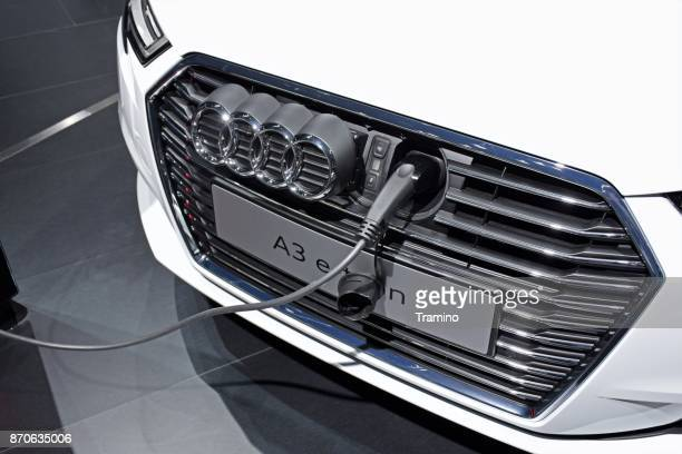 audi a3 e-tron on the charging station - hybrid car stock pictures, royalty-free photos & images