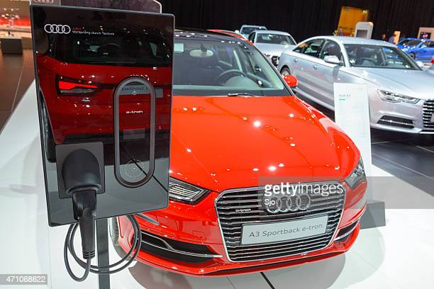 Audi A3 Sportback e-tron with an electric vehicle charging station