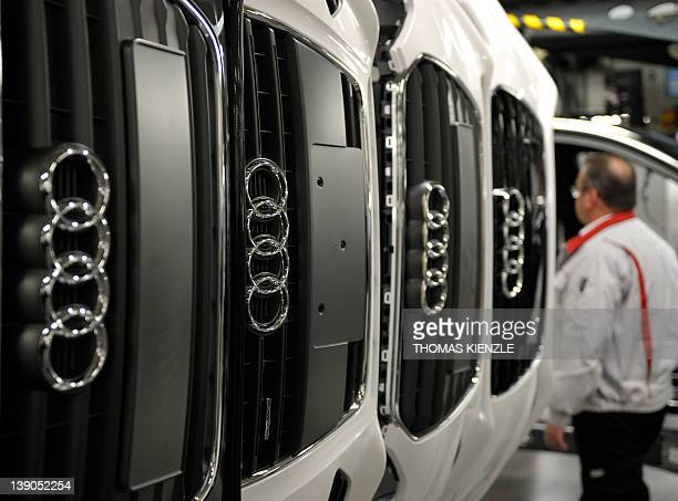 Audi A4 radiator grills are stored next to an assembly line at the Audi plant in Neckarsulm southwestern Germany on February 15 2012 Audi is a...