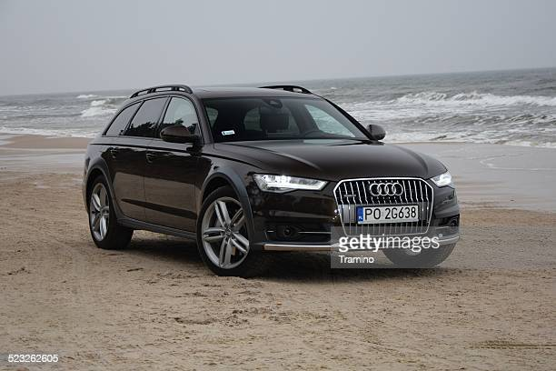 audi a6 allroad on the beach - audi a6 stock photos and pictures