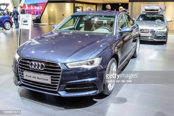 Audi A6 Berline luxury sedan with an Audi A6 Avant station wagon in the background on display at Brussels Expo on January 13 2017 in Brussels Belgium...