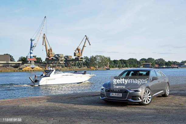 audi a6 on the shore of the port - audi a6 stock photos and pictures