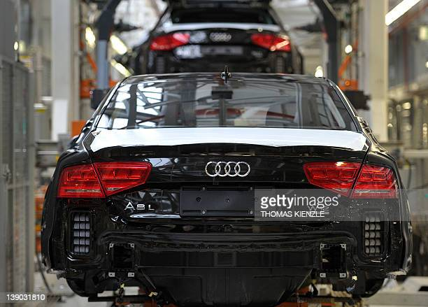 Audi A8 cars are pictured at the assembly line of the Audi plant in Neckarsulm southwestern Germany on February 15 2012 Audi is a subsidiary of...