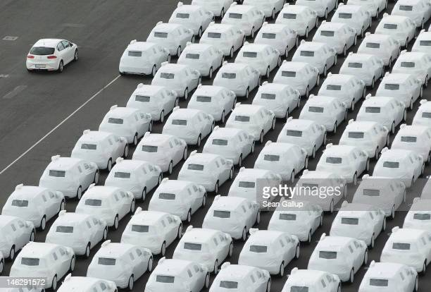 Audi and Volkswagen cars destined for export stand in Emden port on June 13 2012 in Emden Germany Volkswagen announced strong results in June with...