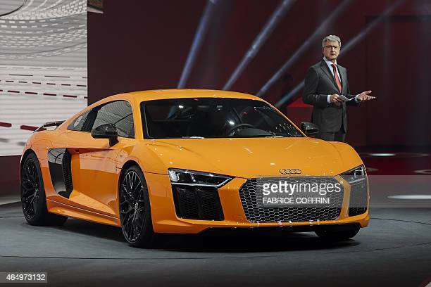 Audi chairman Rupert Stadler presents the new Audi R8 V10 plus during a preview of German carmaker Volkwagen Group on March 2 2015 ahead of the...