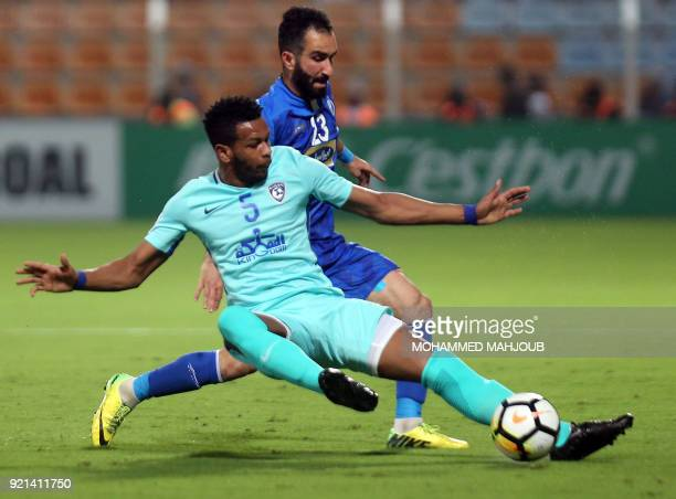 audi club AlHilal's Ali Hadi ALBulayhi fights for the ball with Dariush Shojaeian of Iranian club Esteghlal during during their Asian Champions...