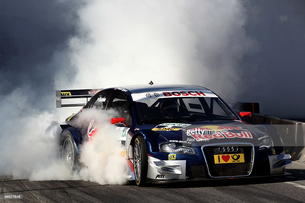 Audi driver Mattias Ekstroem of Sweden steers his car during the presentation of the German Touring Car Championship DTM in front of the Kurhaus on April 18, 2010 in Wiesbaden, Germany.
