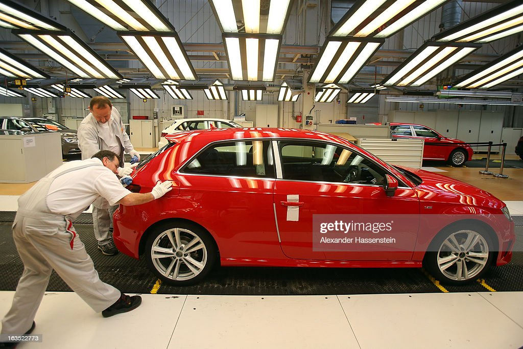 Audi employee carrie out the final inspection on a Audi A3 automobiles, produced by Volkswagen AG's Audi brand, as they move along the production line at the company's plant in Ingolstadt, Germany, on Monday, March 11, 2013. Audi is set to spend 13 billion euros ($17 billion) through 2016 to expand and develop new cars pursuing BMW's sales lead.