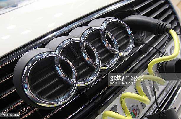 A Audi etron car is plugged for charging during the second press day of the 66th IAA auto show in Frankfurt am Main western Germany on September 15...