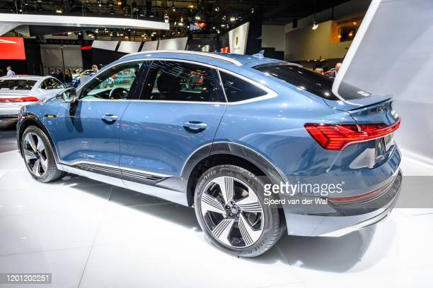 Audi e-tron Sportback full electric luxury crossover SUV car on display at Brussels Expo on January 9, 2020 in Brussels, Belgium. The Sportback is a...
