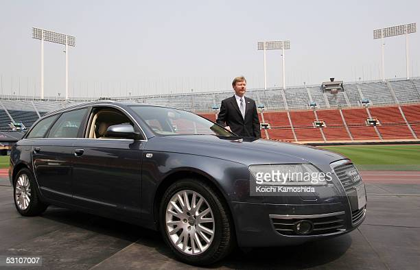 Audi Japan KK President Walter Hanek poses with the new Audi A6 Avant during a media event at the National Stadium June 20 2005 in Tokyo Japan The...