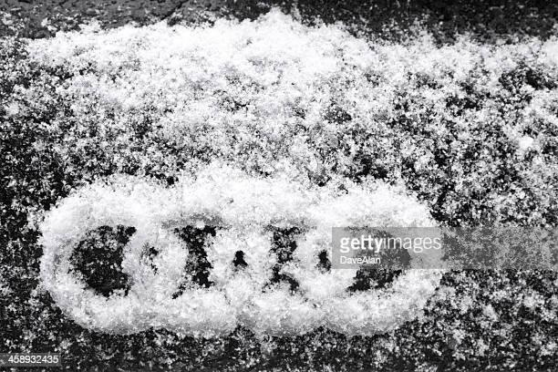 audi logo snow. - audi car stock photos and pictures