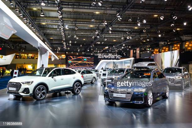 Audi motor show stand with the Audi Q3 sportback and Audi A6 Avant in the foreground on display at Brussels Expo on January 9, 2020 in Brussels,...