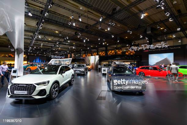 Audi motor show stand with the Audi Q3 sportback, Audi A6 Avant and Audi RS4 in the foreground on display at Brussels Expo on January 9, 2020 in...