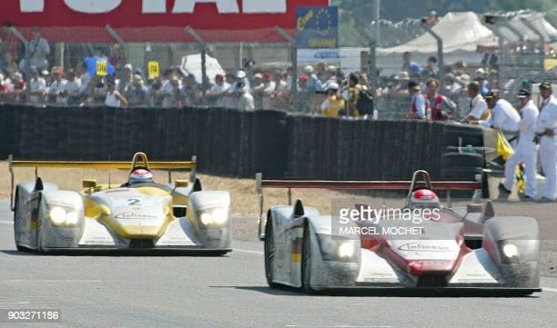 L'Audi numéro 1 pilotée par l'Italien Emanuele Pirro l'Allemand Franck Biela et le Danois Tom Kristensen passe en vainqueur la ligne d'arrivée de la...
