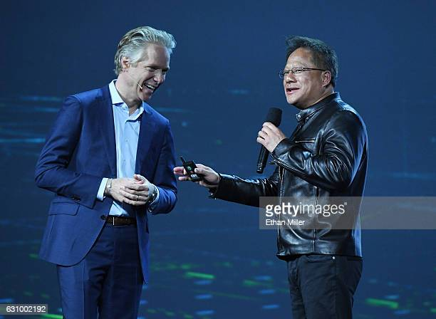 Audi of America President Scott Keogh and Nvidia Founder President and CEO JenHsun Huang speak during Huang's keynote address at CES 2017 at The...