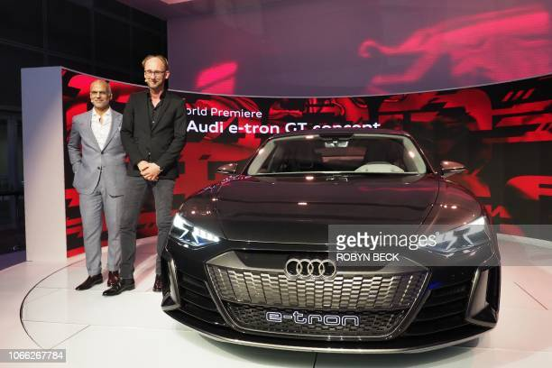 Audi President for North America Mark Del Rosso and Audi head of design Marc Lichte pose with the Audi ETron GT concept car at AutoMobility LA the...