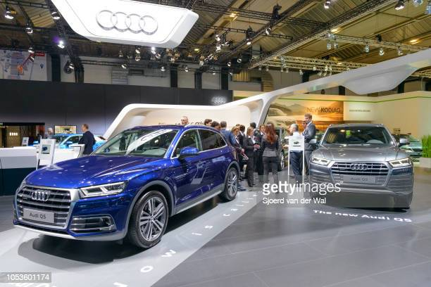 Audi Q5 luxury SUV cars front view on display at Brussels Expo on January 13, 2017 in Brussels, Belgium. The second generation Q5 sits in the middle...