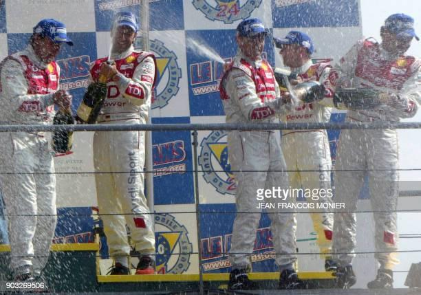Audi R10 diesel drivers Germans Franck Biela and Marco Werner Italian Rinaldo Capello Briton Allan McNish and Danish Tom Kristensen celebrate on the...