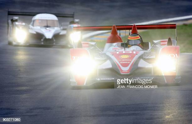 Audi R10 diesel prototype N°1 driven by German Franck Biela and the Peugeot 908 HDiFAP N°9 run on June 1 2008 in Le Mans western France during a free...