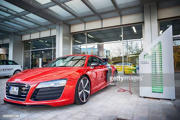 audi r8 e-tron at charging station. - compact car stock photos and pictures