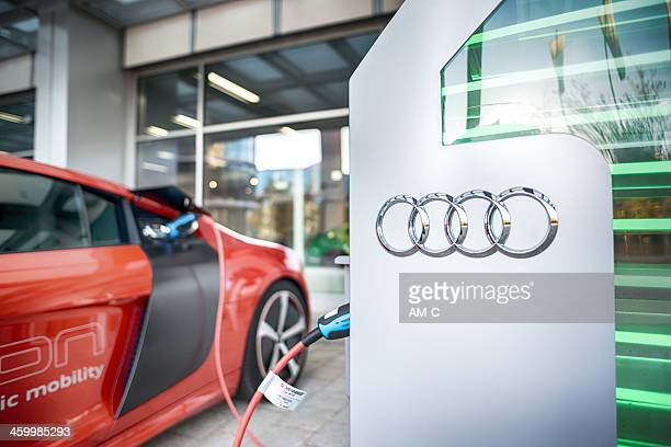 Audi R8 e-tron at charging station.