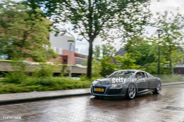 audi r8 quattro coupe sports car driving in the rain - audi stock pictures, royalty-free photos & images