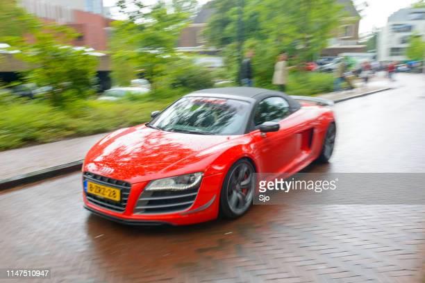 Audi R8 Spyder sports car driving in the rain