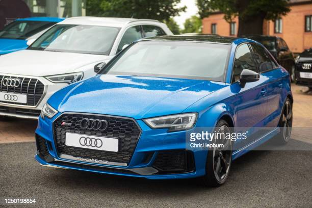 audi rs3 saloon in ara blue paint - audi stock pictures, royalty-free photos & images