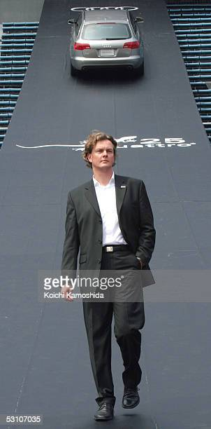 Audi senior designer Torsten Wenzel appears with the new Audi A6 Avant during a media event at the National Stadium June 20 2005 in Tokyo Japan The...