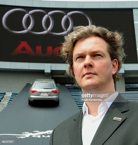Audi senior designer Torsten Wenzel poses with the new Audi A6 Avant during a media event at the National Stadium June 20 2005 in Tokyo Japan The...