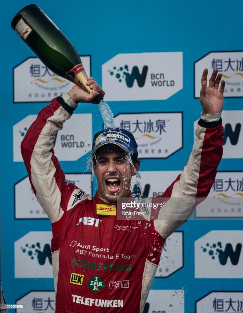 Audi Sport ABT driver Lucas di Grassi of Brazil celebrates on the podium after winning the inaugral FIA Formula E Beijing ePrix Championship race on September 13, 2014 in Beijing, China. The electric car racing series is set to be hosted in nine other cities worldwide.