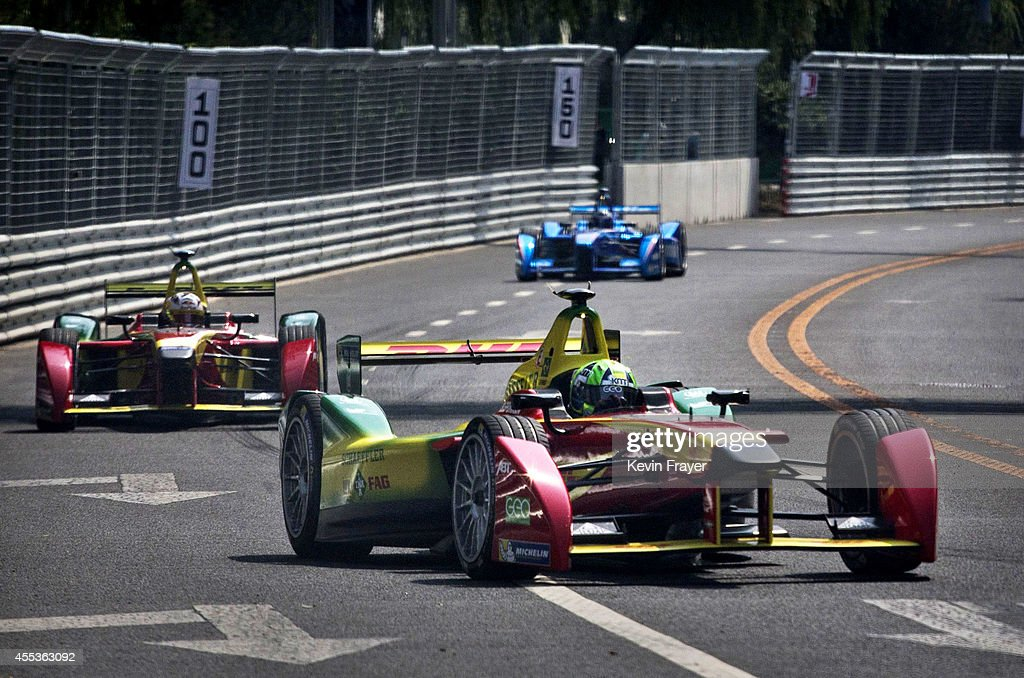 Audi Sport ABT driver Lucas di Grassi of Brazil leads teammate Daniel Abt through a turn on his way to winning the inaugral FIA Formula E Beijing ePrix Championship race on September 13, 2014 in Beijing, China. The electric car racing series is backed by many of the major sponsors of the main Formula One circuit, and is set to be hosted in nine other cities worldwide.