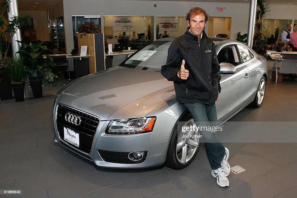 Audi Sport Driver Emanuele Pirro Signs Mural At Palisades Audi - Palisades audi