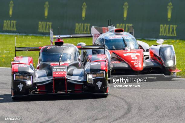 Audi Sport Team Joest R18 e-tron quattro Le Mans Prototype race car driven by Mike Conway, Kamui Kobayashi and Jose Maria Lopez followed by the...